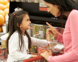 Girl Having Argument With Mother At Candy Counter